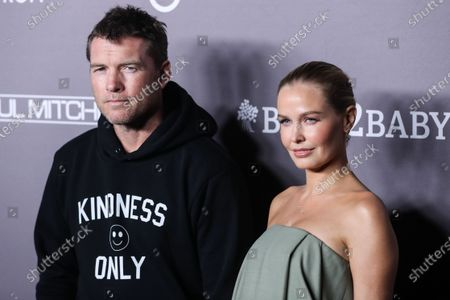 Sam Worthington and wife/Lara Worthington arrive at the 2019 Baby2Baby Gala held at 3Labs on November 9, 2019 in Culver City, Los Angeles, California, United States.