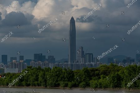 Stock Image of The Ping An tower in Shenzhen can be seen from Nam Sang Wai, the wetlands of Hong Kong.  On 15 August 2021, in Hong Kong, China.