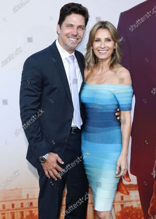Michael Trucco and Sandra Hess arrive at the Los Angeles Premiere Of Lionsgate's 'Angel Has Fallen' held at the Regency Village Theatre on August 20, 2019 in Westwood, Los Angeles, California, United States.