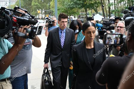 Lawyers for R Kelly arrive at the trial of Robert Sylvester Kelly, accused of sex trafficking and racketeering, at Brooklyn's federal court in New York.