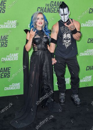Stock Photo of Alissa White Gluz and Doyle Wolfgang von Frankenstein arrive at the Los Angeles Premiere Of 'The Game Changers' held at ArcLight Cinemas Hollywood on September 5, 2019 in Hollywood, Los Angeles, California, United States.