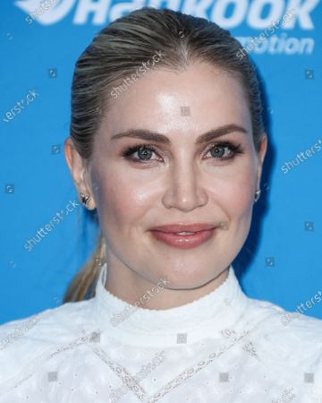 Stock Photo of American singer Willa Ford arrives at Clayton Kershaw's 7th Annual Ping Pong 4 Purpose Fundraiser held at Dodger Stadium on August 8, 2019 in Los Angeles, California, United States.