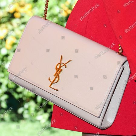 Jessica Lowndes, bag detail, arrives at the 10th Annual Veuve Clicquot Polo Classic Los Angeles held at Will Rogers State Historic Park on October 5, 2019 in Pacific Palisades, Los Angeles, California, United States.