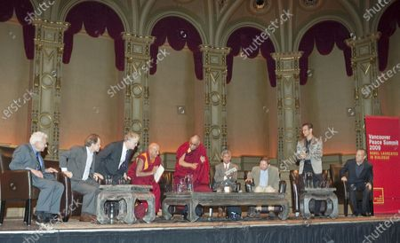 L. to R. Murray Gell-Mann, Daniel Siegel MD, Sir Ken Robinson, Buddhist monk Thupten Jinpa, Dalai Lama, Interpreter, Eckhart Tolle, and two members of the Blue Man group participate in a morning panel discussion during the 2009 Vancouver Peace Summit at the Orpheum Theater in Vancouver, British Columbia, September 29, 2009.