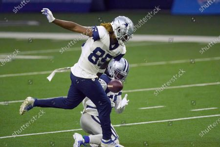 Dallas Cowboys cornerback Kelvin Joseph (24) breaks up a pass intended for Dallas Cowboys wide receiver Noah Brown (85) during during NFL football practice in Frisco, Texas
