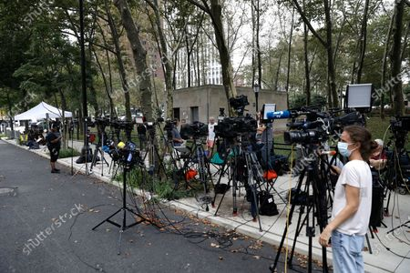 The media is staked out outside of the US federal courthouse in the borough of Brooklyn for the start of the R. Kelly's federal trial in New York, New York, USA, 18 August 2021. US singer R. Kelly his real name Robert Sylvester Kelly is accused of a single count of racketeering with 14 underlying acts, including sex trafficking, kidnapping, forced labor and eight counts of violating the Mann Act, which prohibits sex trafficking across state lines.