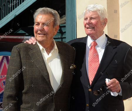 """Actor Peter Graves (R) is joined by actor Mike Connors during dedication ceremonies for Graves' star on the Hollywood Walk of Fame on October 30, 2009 in Los Angeles. His movie career spanned classics such as """"Stalag 17"""" to comedies such as """"Airplane!"""", but he is best remembered by many as the head of the """"Mission: Impossible"""" force in the 1960s and 70s."""