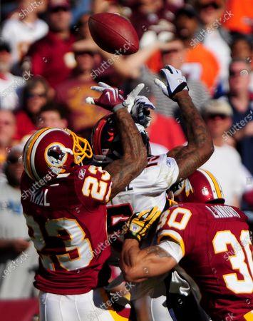 Washington Redskins' DeAngelo Hall (23) breaks up a pass intended for Denver Broncos' Brandon Marshall as David Burton (30) assist, during the second quarter at FedEx Field in Landover, Maryland on November 15, 2009.