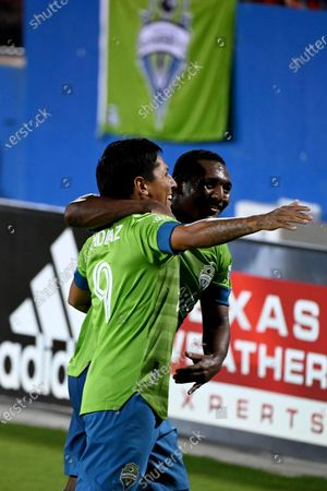 Seattle Sounders forward Raul Ruidiaz (9) celebrates his goal with midfielder Jimmy Medranda (94) in the second half during an MLS soccer match against FC Dallas, in Frisco, Texas