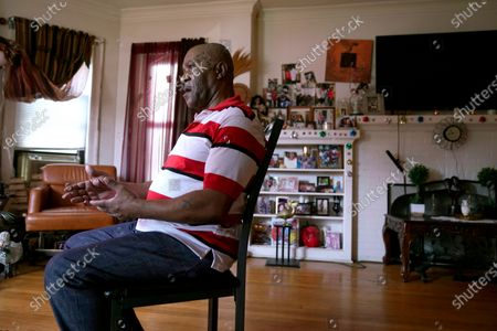 """Michael Williams sits for an interview in his South Side Chicago home . After prosecutors used ShotsSpotter evidence to build their case against Williams, who spent 11 months behind bars before being released, he said, """"I kept trying to figure out, how can they get away with using the technology like that against me?"""" he asked. """"That's not fair."""" Williams was released after nearly a year because of insufficient evidence"""