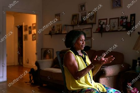 Michael Williams' wife Jacqueline Anderson speaks during an interview, in Chicago. When her husband was in jail, she pleaded with him to remember their fishing trips with the grandchildren, how he used to braid her hair, anything to jar him back to his world outside the concrete walls of Cook County Jail