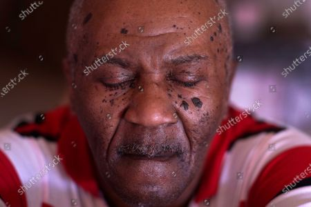 Michael Williams closes his eyes for a portrait in his South Side Chicago home . Williams was behind bars for nearly a year before a judge dismissed the murder case against him in July at the request of prosecutors, who said they had insufficient evidence