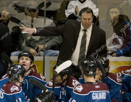 Colorado Avalanche head coach Joe Sacco talks to his team while awaiting a ruling on an Avalanche goal against the New Jersey Devils during the first period at the Pepsi Center in Denver on January 16, 2010.