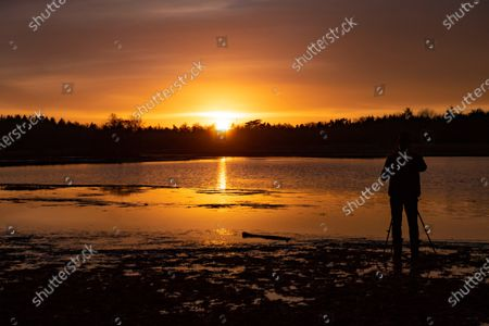 Editorial photo of Shilhouette Of Photographer During The Sunset In The Netherlands, Eindhoven - 25 Jan 2021