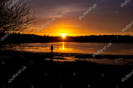Editorial image of Shilhouette Of Photographer During The Sunset In The Netherlands, Eindhoven - 25 Jan 2021