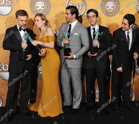 """Actors Christoph Waltz, Diane Kruger, Eli Roth, B.J. Novak and Omar Doom (L-R), cast members in the film """"Inglourious Basterds"""" appear backstage after winning best performance by a cast in a motion picture at the 16th annual Screen Actors Guild Awards in Los Angeles on January 23, 2010."""