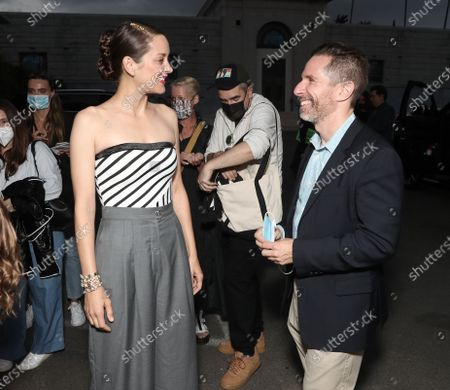 """Marion Cotillard and Prime Video Movies Sr. Exec of Development Scott Foundas attend Amazon Studios """"Annette"""" Los Angeles Premiere on Wed Aug 18, 2021 in Los Angeles."""