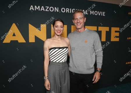 """Marion Cotillard and Co-Head of Movies at Amazon Studios Matt Newman, Devyn McDowell attends Amazon Studios """"Annette"""" Los Angeles Premiere on Wed Aug 18, 2021 in Los Angeles."""