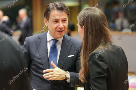 Prime Minister of Italy Giuseppe Conte talks and gestures with PM of Slovenia Marjan Sarec and Prime Minister of Finland Sanna Marin. The Italian PM as seen arriving and talking with EU leaders at the roundtable during the second day of the European Council - Euro summit - EU leaders meeting in Brussels, Belgium - December 13, 2019