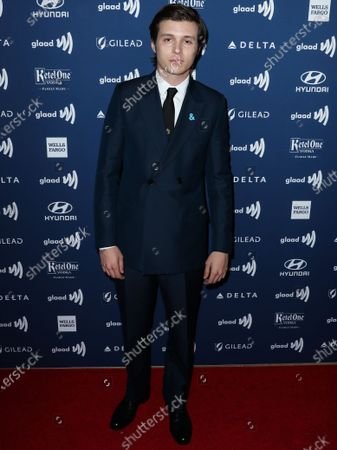 Actor Nick Robinson wearing Dior Men arrives at the 30th Annual GLAAD Media Awards held at The Beverly Hilton Hotel on March 28, 2019 in Beverly Hills, Los Angeles, California, United States.