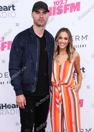 Mike Caussin and Jana Kramer arrive at the 2019 iHeartRadio Wango Tango held at The Dignity Health Sports Park on June 1, 2019 in Carson, Los Angeles, California, United States.