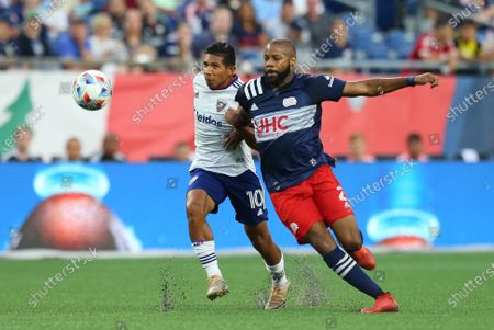 Foxborough, MA, USA; New England Revolution defender Andrew Farrell (2) and D.C. United forward Edison Flores (10) in action during an MLS match between D.C. United and New England Revolution at Gillette Stadium