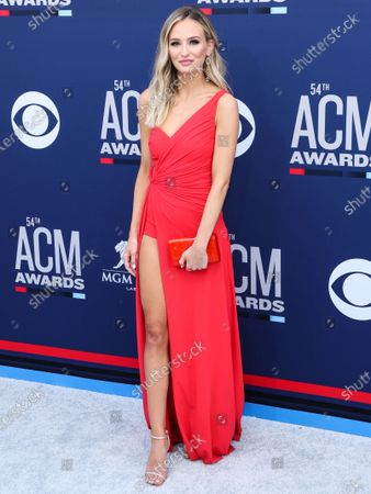 Lauren Bushnell arrives at the 54th Academy Of Country Music Awards held at the MGM Grand Garden Arena on April 7, 2019 in Las Vegas, Nevada, United States.