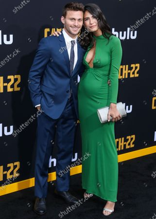 Jon Rudnitsky and Courtney Grant arrive at the Los Angeles Premiere Of Hulu's 'Catch-22' held at the TCL Chinese Theatre IMAX on May 7, 2019 in Hollywood, Los Angeles, California, United States.