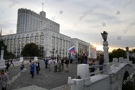 Stock Picture of People who turned up to oppose a hard-line Soviet coup in August 1991, sgather with a Russian national flag to mark the 30th anniversary of the first day of the failed coup outside the Russian Government also known as White House building in Moscow, Russia, . The world held its breath 30 years ago when a group of top Communist officials ousted Soviet leader Mikhail Gorbachev and flooded Moscow with tanks. But instead of bringing a rollback of liberal reforms and a return to Cold War confrontations, the August 1991 coup collapsed in just three days and precipitated the breakup of the Soviet Union a few months later