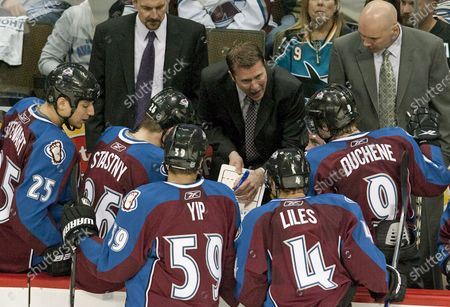 Colorado Avalanche head coach Joe Sacco (C) works out a play for his team during the third period at the Pepsi Center on April 4, 2010 in Denver.   Colorado earned two points by beating San Jose in overtime 5-4.