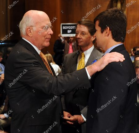 Sen. Patrick Leahy, D-VT, Keith Jones and Christopher Jones (L to R) chat prior to a Senate Judiciary Committee hearing on the effects of  recent court decisions and liability caps on corporate responsibility on Capitol Hill in Washington on June 8, 2010. Gordon Jones, Keith's son and Christopher's brother, was killed in the April 20 explosion on the Deepwater Horizon oil rig.