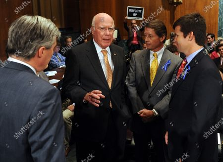 Sen. Sheldon Whitehouse, D-RI, Sen. Patrick Leahy, D-VT, Keith Jones and Christopher Jones (L to R) chat prior to a Senate Judiciary Committee hearing on the effects of  recent court decisions and liability caps on corporate responsibility on Capitol Hill in Washington on June 8, 2010. Gordon Jones, Keith's son and Christopher's brother, was killed in the April 20 explosion on the Deepwater Horizon oil rig.