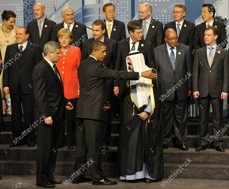 U.S. President Barack Obama (C) gestures to Saudi Arabia's King and Prime Minister Abdullah Bin Abd al-Aziz Al Saud as they arrive for a group photo during the G20 Summit in Toronto, Ontario on June 27, 2010.