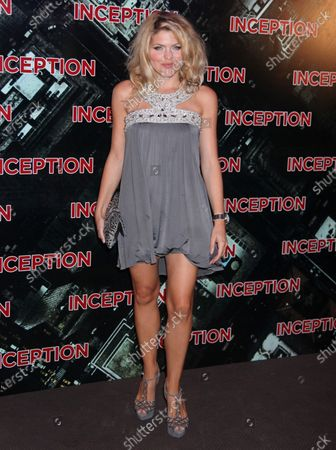 """Celine Durand arrives at the French premiere of the film """"Inception"""" in Paris on July 10, 2010."""
