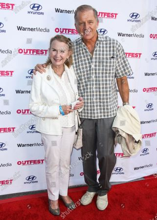 Actress Juliet Mills and husband/actor Maxwell Caulfield arrive at the 2021 Outfest Los Angeles LGBTQ Film Festival Screening Of 'The Sixth Reel' held at the Directors Guild of America on August 19, 2021 in Los Angeles, California, United States.