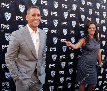 Actors and husband and wife Angelo Pagan (L) and Leah Remini attend FOX Sports/PAC-10 Conference Hollywood premiere night at 20th Century FOX Studios in Los Angeles on July 29, 2010.