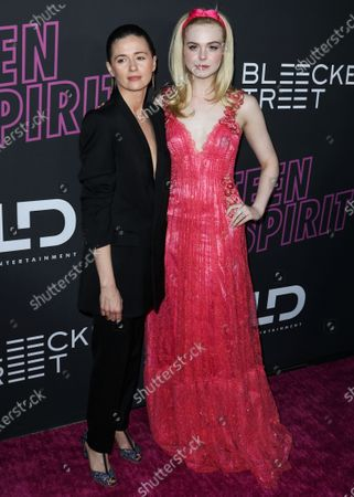 Actresses Agnieszka Grochowska and Elle Fanning arrive at the Los Angeles Special Screening Of Bleecker Street's 'Teen Spirit' held at ArcLight Cinemas Hollywood on April 2, 2019 in Hollywood, Los Angeles, California, United States.