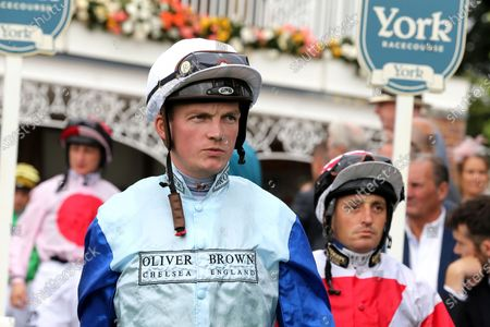 Jockey Rob Hornby winner of The Sky Bet Handicap Stakes over 1m 4f (£70,000) on Sam Cooke during the Ebor Meeting horse racing at York Racecourse, York