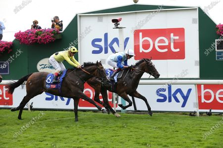 SAM COOKE (13) ridden by Rob Hornby and trained by Ralph Beckett winning The Sky Bet Handicap Stakes over 1m 4f (£70,000)  during the Ebor Meeting horse racing at York Racecourse, York