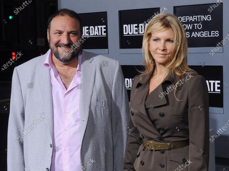 """Producer Joel Silver and his wife Karyn Fields attend the premiere of the motion picture comedy """"Due Date"""", at Grauman's Chinese Theatre in the Hollywood section of Los Angeles on October 28, 2010."""
