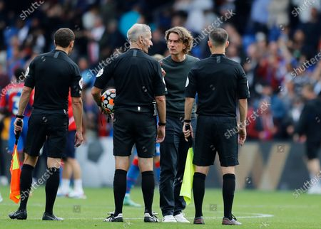 Brentford Manager Thomas Frank talking to Referee Martin Atkinson and his assistants after full time; Selhurst Park, Crystal Palace, London, England, Premier League football, Crystal Palace versus Brentford.
