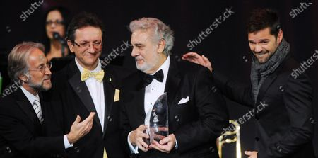 Latin Recording Academy President Gabriel Abaroa Jr., Recording Academy's president/CEO Neil Portnow, honoree Placido Domingo, singer Ricky Martin and Chairman of the Latin Recording Academy Luis Cobos (L-R) are seen onstage during the 2010 Person of the Year dinner honoring Domingo at the Mandalay Bay in Las Vegas, Nevada on November10, 2010.