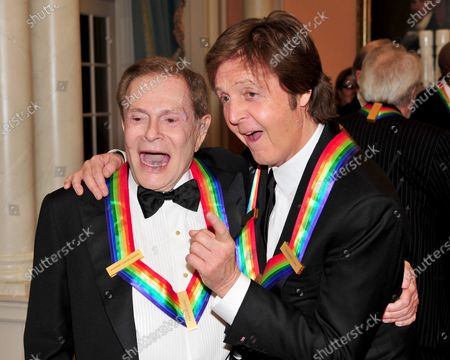 2010 Kennedy Center honorees Jerry Herman, left, and Sir Paul McCartney, right, after posing for their formal class photo following the formal Artist's Dinner at the United States Department of State in Washington, D.C. on Saturday, December 4, 2010.