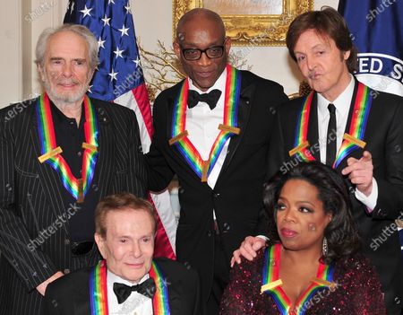The 2010 Kennedy Center honorees pose for their formal class photo following the formal Artist's Dinner at the United States Department of State in Washington, D.C. on Saturday, December 4, 2010.  Top row, from left to right: Merle Haggard, Bill T. Jones, and Sir Paul McCartney. Bottom row, from left to right: Jerry Herman and Oprah Winfrey.