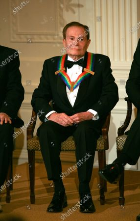 Jerry Herman listens to remarks by U.S. President Barack Obama as the president and First Lady Michelle Obama host the 2010 Kennedy Center Honorees at a reception in the East Room of the White House before going to the Kennedy Center on December 5, 2010.  The recipients for the 33rd annual awards are singer and songwriter Merle Haggard; composer and lyricist Jerry Herman; dancer, choreographer and director Bill T. Jones; songwriter and musician Paul McCartney; and producer, television host and actress Oprah Winfrey.