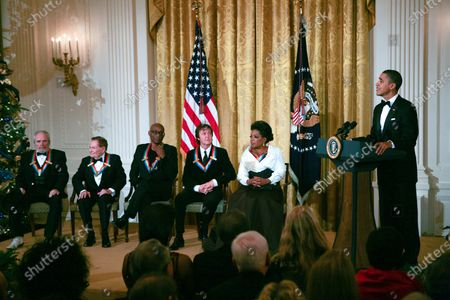 U.S. President Barack Obama and First Lady Michelle Obama host the 2010 Kennedy Center Honorees at a reception in the East Room of the White House before going to the Kennedy Center on December 5, 2010.  The recipients for the 33rd annual awards are singer and songwriter Merle Haggard; composer and lyricist Jerry Herman; dancer, choreographer and director Bill T. Jones; songwriter and musician Paul McCartney; and producer, television host and actress Oprah Winfrey.