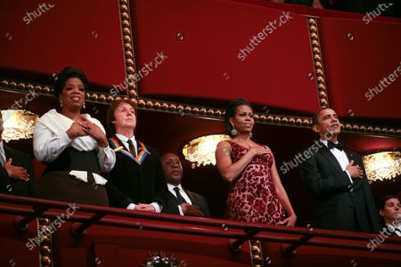 Oprah Winfrey (L) sing the National Anthem along with U.S. President Barack Obama First Lady Michelle Obama as Paul McCartney listens at the Kennedy Center on December 5, 2010. The recipients for the 33rd annual Kennedy Center honors are singer and songwriter Merle Haggard; composer and lyricist Jerry Herman; dancer, choreographer and director Bill T. Jones; songwriter and musician Paul McCartney; and producer, television host and actress Oprah Winfrey.