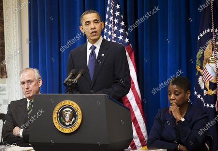 Stock Picture of U.S. President Barack Obama speak to the President's Export Council as James McNerney, Jr., left, chairman, president and chief executive officer of Boeing, and Ursula M. Burns, chief executive officer of Xerox, listen in the Eisenhower Executive Office Building adjacent to the White House in Washington on December 9, 2010.