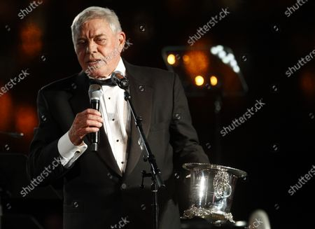 """Tom T. Hall accepts the Icon Award at the 60th Annual BMI Country Awards in Nashville, Tenn. Singer-songwriter Tom T. Hall, who composed """"Harper Valley P.T.A."""" and sang about life's simple joys as country music's consummate blue collar bard, has died. He was 85. His son, Dean Hall, confirmed the musician's death Friday, Aug. 20, 2021 at his home in Franklin, Tennessee"""