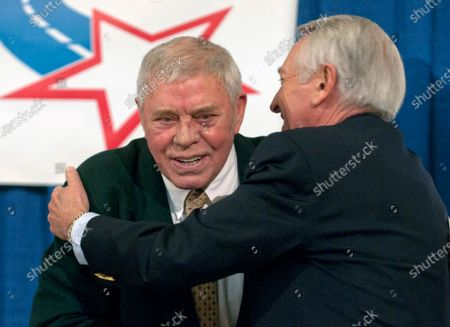 """Country music great Tom T. Hall, left, gets a hug from Kentucky Gov. Steve Beasher during after promoting a Country Music Road to Fame talent contest at the Capitol in Frankfort, Ky. Singer-songwriter Tom T. Hall, who composed """"Harper Valley P.T.A."""" and sang about life's simple joys as country music's consummate blue collar bard, has died. He was 85. His son, Dean Hall, confirmed the musician's death Friday, Aug. 20, 2021 at his home in Franklin, Tennessee"""
